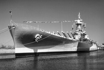 The USS North Carolina at its berth in Wilmington. Photograph by Charles E. Jones. North Carolina Department of Transportation.