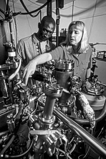 A doctoral student and faculty adviser look over equipment in the Physics Department's nanotribology laboratory. Photograph by Roger Winstead. Courtesy of North Carolina State University.
