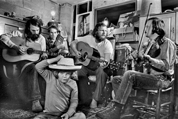The Red Clay Ramblers practice in Tommy Thompson's basement in Chapel Hill, ca. 1974. Left to right: Jim Watson, Mike Craver, Tommy Thompson, and Bill Hicks. Thompson's son, Tom Ashley, is in the foreground. Photograph by John Rosenthal.