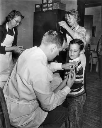 A student receives a polio vaccination on the first day they were administered in North Carolina schools, 18 Apr. 1955. Photograph by Roland Giduz. North Carolina Collection, University of North Carolina at Chapel Hill Library.
