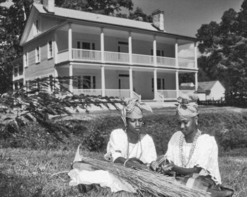 A contemporary interpretive demonstration of slave labor outside the plantation house at Somerset Place. Photograph by Charles E. Jones. North Carolina Department of Transportation.