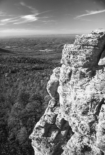 Rock formations tower above the surrounding landscape at Hanging Rock State Park in Stokes County. Photograph courtesy of North Carolina Division of Tourism, Film, and Sports Development.