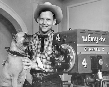 Jim Tucker, star of the Old Rebel-Pecos Pete Show, and his boxer, Troubles, 1958. The popular children's program on WFMY-TV in Greensboro was locally produced. Photograph by WFMY-TV. North Carolina Collection, University of North Carolina at Chapel Hill Library.