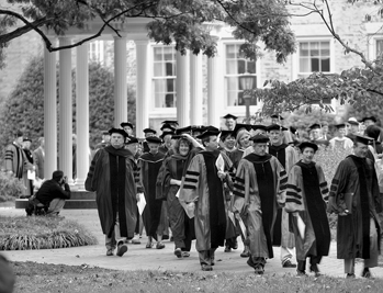 Faculty of the University of North Carolina at Chapel Hill process to a convocation on University Day, late 1990s. The Old Well appears in the background. Photograph by Justin Smith. UNC-Chapel Hill News Services.