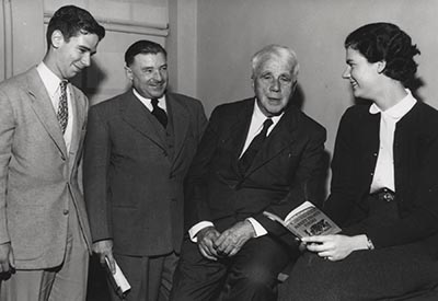 Robert Frost, second from the right, visits with faculty and students at the University of North Carolina at Chapel Hill. Photo from North Carolina Collection, University of North Carolina at Chapel Hill.