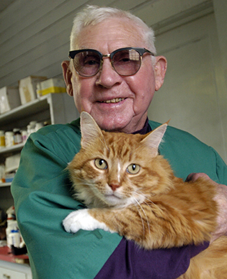 Veterinarian James Everett Brown has a cat of his own. Photo by Chris Seward, 2005.