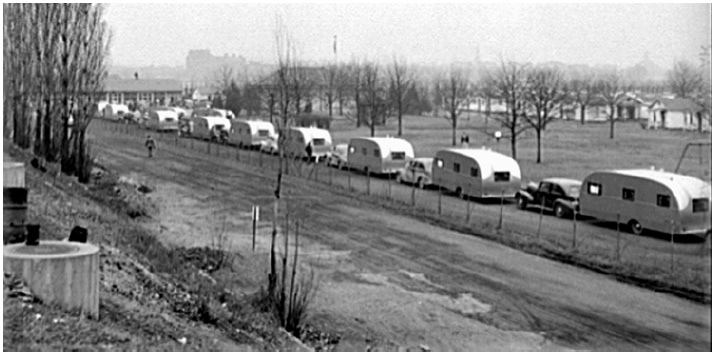 A caravan of fifty trailers— on its way to provide temporary housing in Wilmington—stops for the night outside Washington, D.C. Work in building ships and in other wartime industries brought lots of people from surrounding areas into North Carolina towns.
