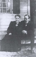 """Eben Alexander sitting with his wife, Marion Howard-Smith Alexander, on the front steps of their Chapel Hill house, c. 1900."" Southern Historical Collection, Wilson Library."