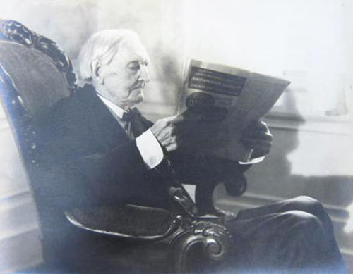 Samuel A. Ashe reading newspapers. Accession #: H.2011.132.5.  North Carolina Museum of History.