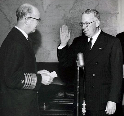 A January 15, 1954 photograph of Thurmond Chatham being sworn in as a Naval Reserve captain. Image from the North Carolina Museum of History.