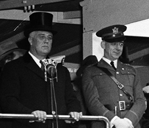 A photograph of Albert Lyman Cox (right) next to president Franklin D. Roosevelt at the April 6, 1938 Army Day Parade in Washington, D.C. Image from the Library of Congress.