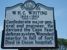 William Henry Chase Whiting's marker on US 421 at Fort Fisher State Historic Site. Photo is courtesy of North Carolina Highway Historical Marker Program.