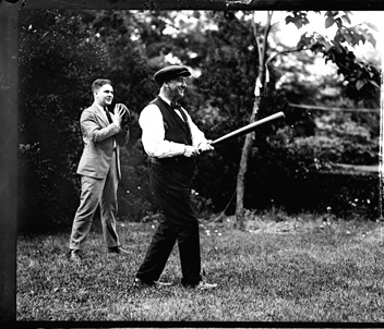Josephus Daniels, Secretary of the Navy [right], playing baseball with son Frank. 1920.  From the National Photo Company Collection, Library of Congress Prints & Photographs Online Catalog.