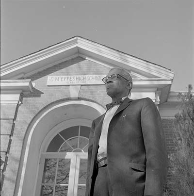 W.H. Davenport standing in front of Greenville, N.C.'s C. M. Eppes High School, January 19, 1961. Item 741.26.a44, from the Daily Reflector Image Collection, East Carolina University Digital Collections.