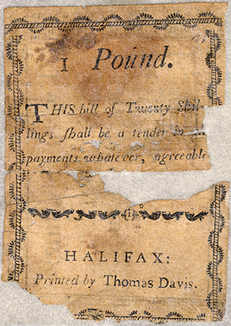"A 20 shilling (1 pound) note printed by Thomas Davis between 1783 and 1785 .  ""Money, Paper, Accession #: H.1971.96.1."" 1783-1785. North Carolina Museum of History."