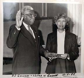 D.D. Garrett and his wife Clotea on December 5, 1988. Taking the oath of office as the first Black County Commissioner. From the Michael Garrett Family private collection. Used by permission.