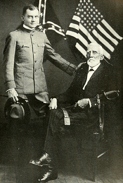 A photograph of George Washington Finley Harper (sitting) with his grandson, Lieut. James C. Harper, published in 1919. Image from the Internet Archive.A