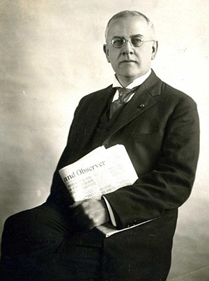 Marshall De Lancey Haywood, holding a copy of the Raleigh News and Observer, circa 1921. Image from the North Carolina Museum of History.