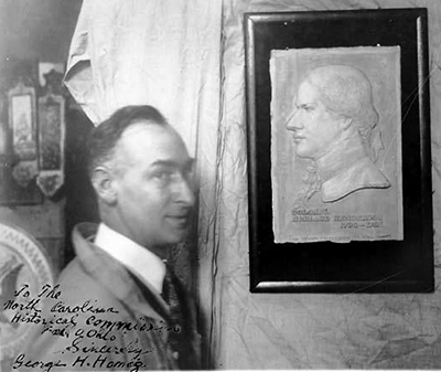 Photograph of a bust of Richard Henderson with the sculptor, George H. Honig, at left. Circa 1910-1930. Image from the North Carolina Museum of History.