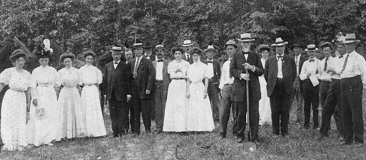 July 02 , 1907 | Identifier: 55-01-0004 Photograph of the groundbreaking ceremony for the East Carolina Teachers Training School. Thomas Jordan Jarvis is right of center with the shovel. Image from the University Archives, East Carolina University.