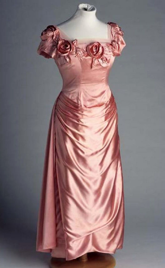 """Dress, Mother of Groom,"" pink satin brocade, made by Willie Otey Kay, 1959. Item H.1980.131.1 from the collection of the North Carolina Museum of History. Used courtesy of the North Carolina Department of Natural and Cultural Resources."