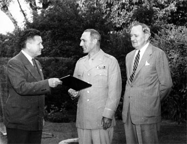 Photograph of Maj. Gen. William Carey Lee (center) with Col. John N. Harrelson, Chancelor of NSCU (left) and G. S. Varris, Assistant Controller (right).  Lee is receiving the honorary degree of Doctor of Military Science.  Item 0226861, Special Collections Research Center, North Carolina State University Libraries, Raleigh, North Carolina.  Used by permission.