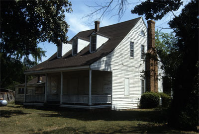 Photograph, Side view, Mallett Rogers House, Fayetteville, Cumberland County, North Carolina. The dwelling, held in the Mallett family from 1778, was occupied by Charles Peter Mallett, father of Charles Beatty Mallett, who moved it from Fayetteville to Eutaw Springs around 1830. Charles Beatty Mallett also resided in the dwelling until he sold it in 1857. Image used by permission from Preservation North Carolina.  Image from Rare & Unique Collections, NCSU Libraries.