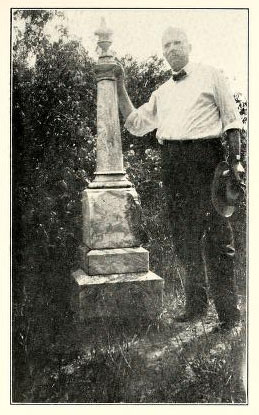 Photograph of monument at the grave of Hector McLean, Edenborough, Hoke County, N.C., with Dr. A. T. Bethune shown next to monument.  From the <i>Transactions of the Medical Society of the State of North Carolina Diamond Jubilee,</i> (Pinehurst, N.C. 1928). Presented on Archive.org.