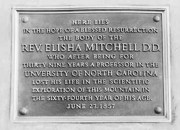 Photograph from 1928 of the memorial plaque set in the stone monument to Elisha Mitchell. Image from the North Carolina Museum of History.