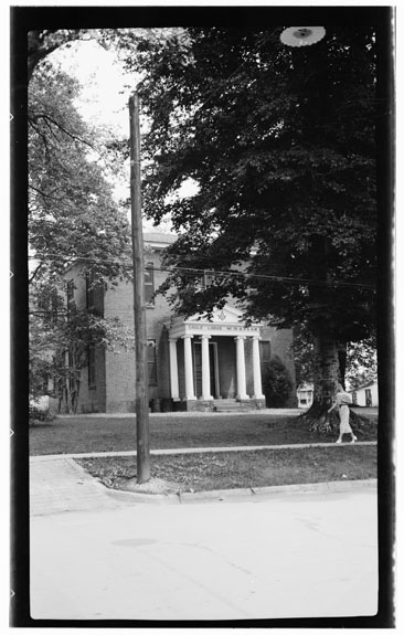 Black and white photograph of Eagle Lodge, 142 West King Street, Hillsborough, Orange County, N.C., by Archie A. Biggs, June 29, 1937. The Eagle Masonic Lodge was designed by William Nichols. From the Historic American Buildings Survey, Library of Congress Prints and Photographs Division.