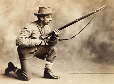 Fred A. Olds dressed and posing as a Civil War soldier in a 1908 photograph. Image from the North Carolina Museum of History.