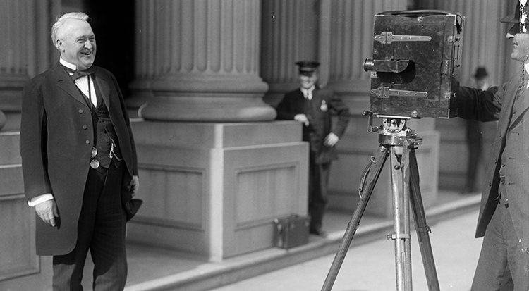 Senator Lee Slater Overman smiling for a movie camera in 1914. Image from the Library of Congress.