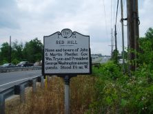 "Photograph of ""Red Hill"" N.C. Historical Highway Marker (#L-84), located in Cabarrus County, North Carolina.  Red Hill was the location of the home and tavern of Martin Phifer.  George Washington is believed to have stayed there on his southern tour in 1791 and was a friend of Martin Phifer, Jr. Image used courtesy of the North Carolina Department of Cultural Resources."
