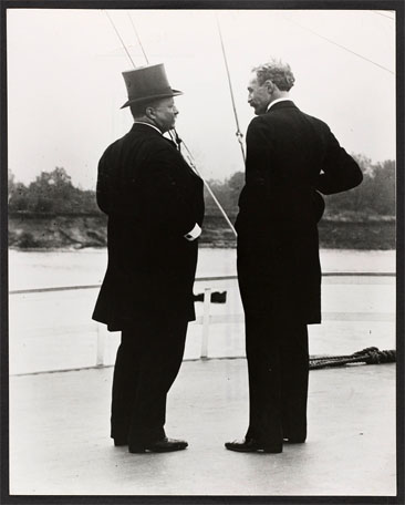 """President Theodore Roosevelt and Chief Forester Gifford Pinchot -- T.R. and G.P. -- on the river steamer Mississippi  This picture was taken on the trip of the Inland Waterways Commission down the Mississippi River in October 1907."" Black and white photograph by the U.S. Forest Service, taken October 1907.  From the Pinchot Collection, Library of Congress, Prints & Photographs Online Catalog."