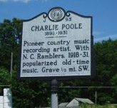 Charlie Clay Poole's mile marker located at NC 14 at SR 1700 (Fisher Hill Road) northwest of Eden in Rockingham County. Presented on North Carolina Highway Historical Marker Program.