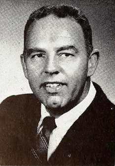 "A photograph of radio broadcaster James William ""Jim"" Reid published in 1957. Image from the Internet Archive."