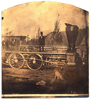 "Photograph of the ""Romulus Saunders,"" an early locomtive of the Raleigh & Gaston Railroad, image circa 1870-1890. Item  H.19XX.135.38, from the North Carolina Museum of History.  Gaston HIllary Wilder was president of the Raleigh & Gaston Railroad beginning in 1858."