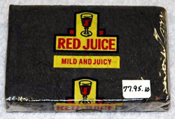 Photograph of a package of T. F. Williamson's Red Juice Chewing Tobacco.  Image courtesy of  the North Carolina Department of Cultural Resources Historic Sites.