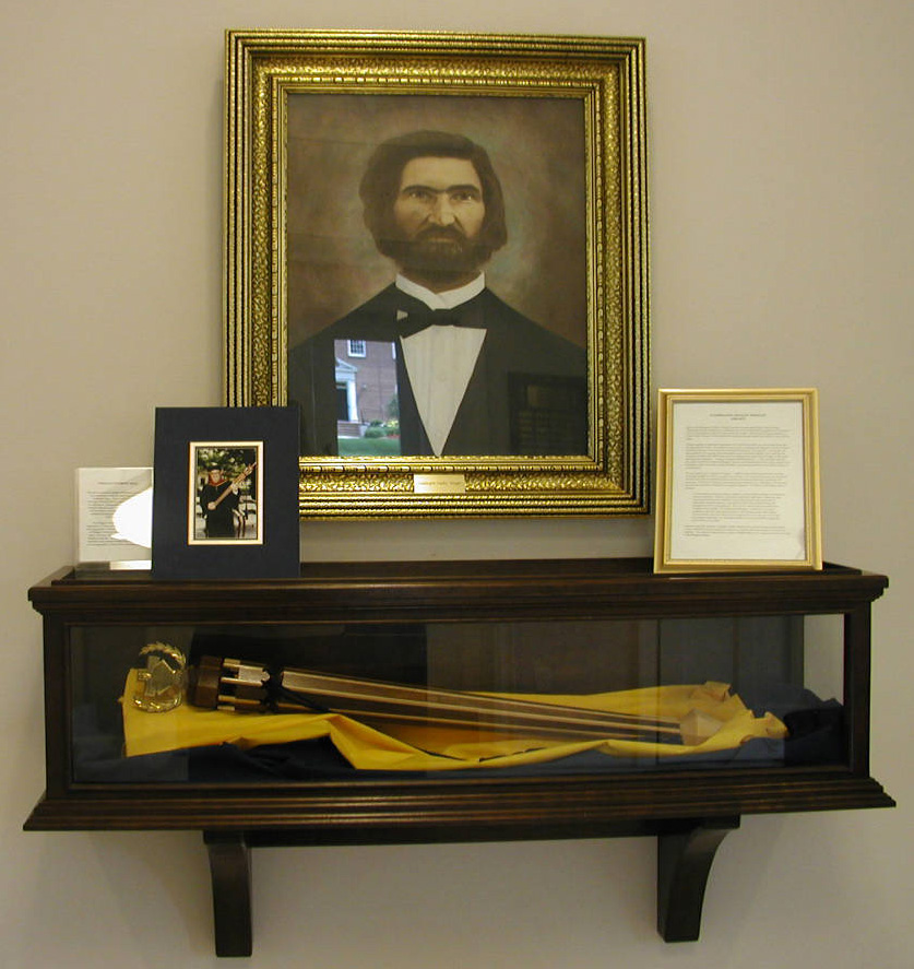 Portrait of Washington Manly Wingate (with other artifacts) in the Wingate University Archives, Wingate, NC.  From North Carolina Cultural Heritage Institutions, NC ECHO Project, North Carolina Digital Collections. The town of Wingate, NC and Wingate University were named in honor of Washington Manly Wingate.