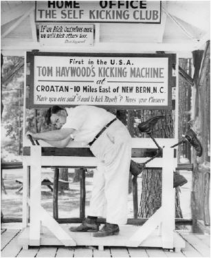 Tom Haywood, of Croatan, demonstrates his kicking machine. Image courtesy of the North Carolina Museum of History.