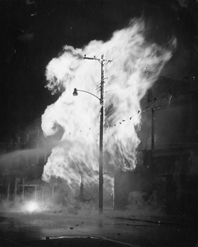 Storms, Fire in Mt. Gilead, NC, 1959, electrical pole on fire at night. From Carolina Power and Light Photograph Collection, NC State Archives, call #:  PhC68_1_457.