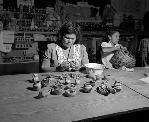 Woman making pottery, 1947