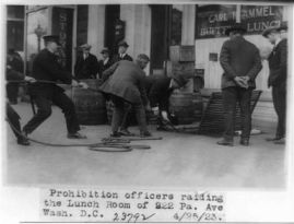 """Prohibition Officers Raiding the Lunchroom of 922 Pa. Ave, Wash. D.C."". 1923. Image courtesy of Library of Congress."