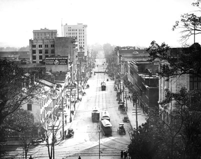 Elevated view of Fayetteville Street, Raleigh, NC, looking south showing the main business district, 1913. From Carolina Power and Light (CP&L) Photograph Collection, North Carolina State Archives, call #:  PhC68_1_90.