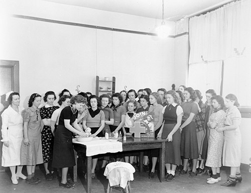 Red Cross Nursing Class, 1938, probably in or near Raleigh, NC. From the Albert Barden Collection, North Carolina State Archives, call #:  N_53_15_6459.