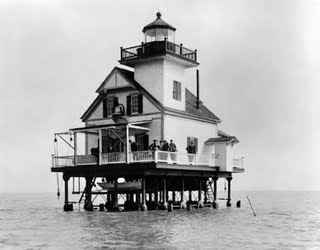 The Roanoke River lighthouse over water.