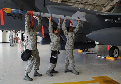"""Crew from the 333rd Aircraft Maintenance Unit attempt to load an AIM-9 Sidewinder missile onto an F-15E Strike Eagle at Seymour Johnson Air Force Base, N.C., Aug. 2, 2012."""