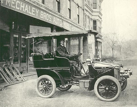 "Joe Mechaley in a ""White"" steam automobile. Early 1900s."