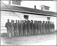 Photograph of all African-American Company E, 4th U.S. Colored Infantry, at Fort Lincoln