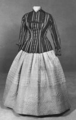 Two piece, brown and beige striped corded taffeta jacket with tortoise shell buttons in floral motif; hand-quiltedbeige taffeta skirt (petticoat), circa 1865. Available from the North Carolina Museum of History.